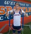 Austin Olive holding 2 hurdles