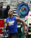 With fans cheering him on in the background, James Harriel of Bloom Township competes in the second heat of the 100 meters during Wednesday's Southland Athletic Conference track meet.