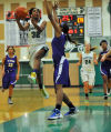 Oak Lawn's LaTondra Brooks goes up for a fast break layup over T.F. North's Tyra Johnson on Thursday night.