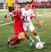 Crown Point's Delany Benich, left, defends against Chesteton's Marissa Montemayor