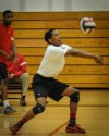 Homewood Flossmoor's Kaleb Johnson handles a Marian serve Tuesday.