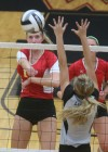Andrean's Marija Nicksic spikes against the block attempt of Lowell's Meagan Fitzgerald on Friday.