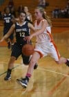 Bishop Noll's Julia Kusiak guards Wheeler's Shannon Eden