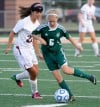 Valparaiso's Emily Farmer kicks the ball away from Chesterton's Caitlin Talaga during Tuesday's game.