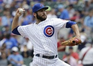 Arrieta pitches Cubs past Rockies