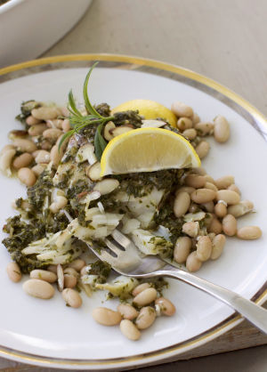 Sauce and beans banish flavorless baked white fish
