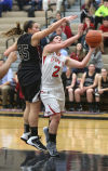 Lowell's Amy Fraikin tries to block a shot by Morton's Rayann Johnston during Friday night's semifinals of the Class 4A Lowell Sectional.