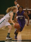Valparaiso's Grace Withrow is guarded by Merrillville's A.J. Downs on Thursday.
