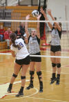 Lowell's Karoline Chraponski and Jordin Page try to block a spike attempt by Highland's Morgan Lenhart on Thursday at the Class 4A Munster Sectional.