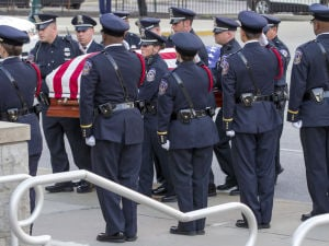 Crowd files in for Indianapolis officer's funeral