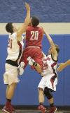 Hebron senior Bryce Hanaway is called for a charging foul against Washington Township junior Dustin Payne