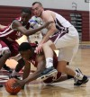 Indiana University Northwest's Matthew Edmonds grabs a loose ball