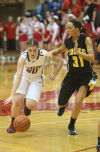 South Central's Olivia Tolmen tries to drive around Kouts' Jayla Crump on Saturday in the PCC tourney championship.