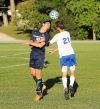 Bishop Noll's Mark Sullivan beats Boone Groove's Cameron Varlan to the ball in the air Thursday.