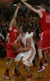Munster's Luke Wuchenich and Nate Bubash double-team Andrean's Sam Toporski under the basket