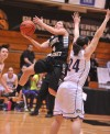 Purdue Calumet's Brooklyn Short drives around Olivet Nazarene's Rachel Kearney on Wednesday night.