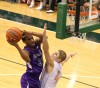 Merrillville's Jamard Owens shoots over Valparaiso's John Mosser on Friday.
