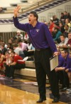 Merrillville coach T.J. Lux barks out orders during Friday's game against Portage.