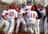 Crown Point players mob pitcher Zach Plesac