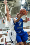 Lake Central's Joe Bannister draws a foul on Michigan City's Dante Combs