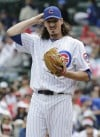 Marmol struggles as Cubs lose to Reds