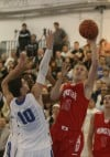 Lake Central's Mike Miklusak tries to stop Munster's Nate Bubash under the basket