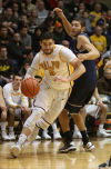 Valparaiso's Bobby Capobianco drives around Loyola Marymount's Marin Mornar on Saturday.