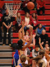 Lake Central's Tara Zlotkowski shoots over Crown Point's Sydney Taylor
