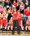 Crown Point's coach Anne Equihua reacts on the sidelines as the Bulldogs fell to LaPorte 72-41 Friday night during the semifinals of the Class 4A Hobart Sectional.