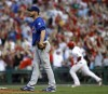 Cubs rally in ninth, win in 11