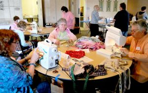 Volunteers sew drain pouches for patients at workshop