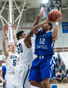 Lake Central's Joe Bannister shoots over Michigan City's Amere Potts