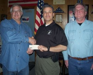 Auxiliary donates to SWAT team