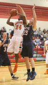 Westville's Chris Wilkins tries to put up a shot past South Central's Johnny Rosenbaum during Thursday's opening round of the Porter County Conference tourney.