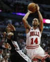 Bulls point guard D.J. Augustin shoots over San Antonio Spurs point guard Patty Mills during the second half Tuesday.