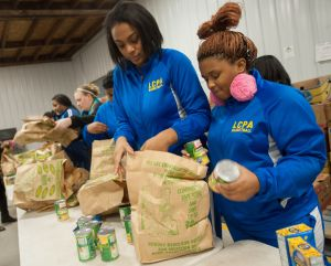Lighthouse girls basketball team opens winter break with community service