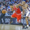 The Bulls' Derrick Rose is fouled by Oklahoma City's Derek Fischer during Wednesday night's preseason game.