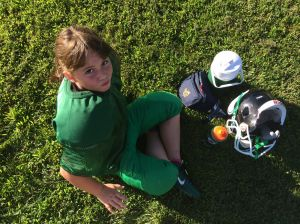 Love of sports sends spunky girl onto the football field