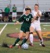 Valparaiso's Grace Withrow, left, and Chesterton's Kaylee Lindahl battle for possession during Tuesday's DAC game.