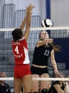 Crown Point's Alaina Chacon and Lake Central's Julia Kruzan battle at the net