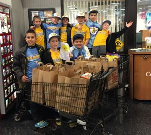 Youth baseball team feeds the hungry