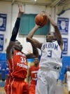 Homewood-Flossmoors Tai Odiase guards Bloom Township's Johnny Griffin