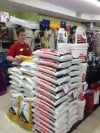 Joe Ferguson of Gus Bock Ace Hardware in Lansing Stocks Bags of Sidewalk Salt