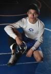 113-pound sophomore wrestler Chris Diaz.
