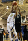 Bishop Noll's Tyreon Gates goes up for a shot against Griffith on Tuesday.