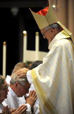Bishop ordains eight men as Gary diocese deacons