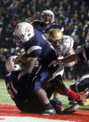 East Chicago Central battles New Prairie in the Class 4A Regional Football Championship