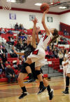 Portage's Hanna Piro draws a foul from the Lowell's Samanatha Roach