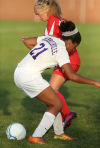 Merrillville's Erika McClinton, left, and Kankakee Valley's Reagan Walther battle for possession in Thursday's Class 2A Crown Point Sectional.