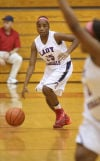 E.C. Central's Laquita Briscoe dribbles the ball down the court against Chesterton on Tuesday.